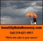 20120618mo-iowa-city-data-recovery-hard-drive-repair-header-woman-umbrella-on-right-with-dot-com-388×370